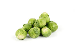 Sprouts. Small pile of raw green sprouts on a reflective white background Stock Images