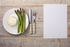 Sprouts of asparagus with tartar sauce on a plate. Stock Photos