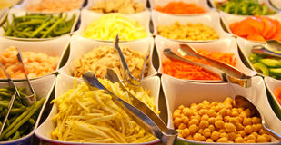 Sprouts and Garbanzo Beans on Salad Bar Stock Photos