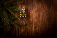 Spruce branch and Christmas tree on wooden planks Royalty Free Stock Photography