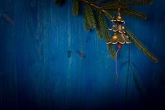 Spruce branch and Christmas tree on wooden planks Royalty Free Stock Photo