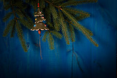 Spruce branch and Christmas tree on wooden planks Stock Photo