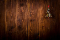Spruce branch and Christmas tree on wooden planks Stock Photos