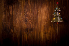 Spruce branch and Christmas tree on wooden planks Royalty Free Stock Images