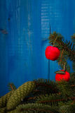Spruce branch and Christmas tree on wooden planks Royalty Free Stock Photos