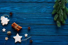 Spruce branch, cones and vintage toys in shape of spruce and stars on blue background for decoration on chrismas or new royalty free stock images