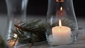 Spruce branch lies amid candles stock video footage