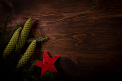 Spruce branch and red star on wooden planks Royalty Free Stock Image