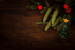 Spruce branch and tiny red apples and christmas tree Royalty Free Stock Photography