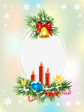 Spruce branches with candles, candy and golden bell. Christmas card template Stock Image