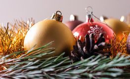 Spruce branches and Christmas balls. Festive background Stock Photography