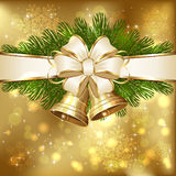 Spruce branches and Christmas bells Royalty Free Stock Photography