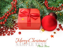 Spruce branches with Christmas decorations and gift box Stock Images