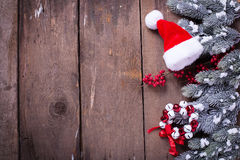 Spruce branches, decorative berries, christmas decorations  on a Royalty Free Stock Photo