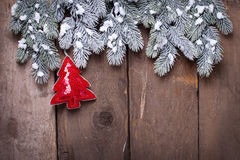 Spruce branches and decorative tree on vintage  wooden  backgrou Royalty Free Stock Image