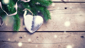Spruce branches  and silver  decorative Christmas heart  on  vin Stock Image