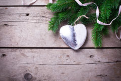Spruce branches  and silver  decorative Christmas heart  on  vin Royalty Free Stock Photography