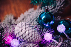 Spruce branches in the snow violet blue and white christmas balls on dark wooden background Stock Photography
