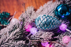 Spruce branches in the snow violet blue and white christmas balls on dark wooden background Stock Image