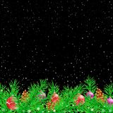 Spruce Christmas black night background. Green spruce and Christmas decoration snow black night background. Falling snowflakes fir tree parts toys pine cones Stock Photo