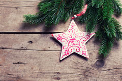 Spruce and decorative star  on wooden background. Royalty Free Stock Image