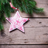Spruce and decorative star  on wooden background. Royalty Free Stock Images
