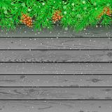 Spruce snow gray wooden background. Spruce pine cone and falling snow gray wooden background. Christmas wood green branches snowy holiday celebration backdrop Royalty Free Stock Photos