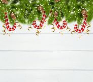 Spruce Twigs Background. New year background with spruce twigs  serpentine and christmas peppermint candy cane realistic vector Illustration Stock Photos