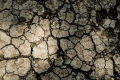 Sprucken jordtextur på bakgrund Arkivbilder