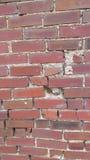 Sprucken och bruten tegelstenvägg Fotografering för Bildbyråer