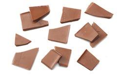 spruckna sötsaker för chokladgodisar på bästa sikt för vit bakgrund Royaltyfri Fotografi
