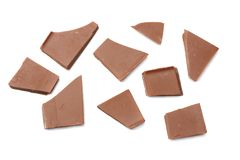 spruckna sötsaker för chokladgodisar på bästa sikt för vit bakgrund Arkivfoton