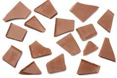 spruckna sötsaker för chokladgodisar som isoleras på bästa sikt för vit bakgrund Arkivfoto