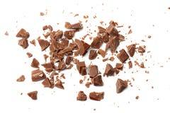 spruckna sötsaker för chokladgodisar som isoleras på bästa sikt för vit bakgrund Arkivbilder
