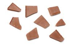 spruckna sötsaker för chokladgodisar som isoleras på bästa sikt för vit bakgrund Royaltyfri Foto