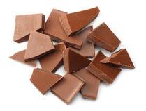 spruckna sötsaker för chokladgodisar som isoleras på bästa sikt för vit bakgrund Royaltyfria Bilder