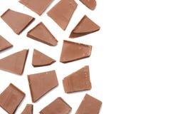 spruckna sötsaker för chokladgodisar som isoleras på bästa sikt för vit bakgrund Arkivbild