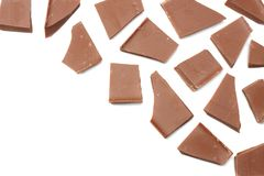spruckna sötsaker för chokladgodisar som isoleras på bästa sikt för vit bakgrund Arkivfoton