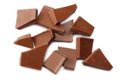 spruckna sötsaker för chokladgodisar som isoleras på bästa sikt för vit bakgrund Royaltyfria Foton