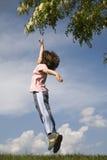 Sprung des Kindes für die Blume Lizenzfreies Stockbild