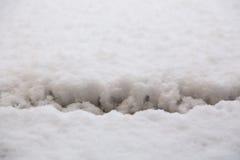 Sprung im Schnee Stockbild