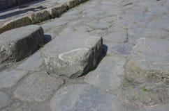 Sprungbrett in den Straßen von Pompeji, Italien Lizenzfreie Stockfotos