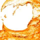 Spruzzata arancio dell'acqua isolata su bianco Fotografia Stock Libera da Diritti