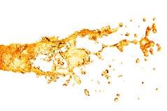 Spruzzata arancio dell'acqua isolata su bianco Fotografia Stock