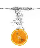 Spruzzata arancione in acqua Fotografia Stock