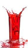 Spruzzata del succo di frutta in glas Fotografie Stock Libere da Diritti