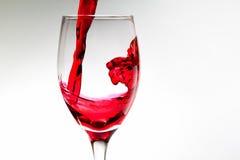 Spruzzata del vino rosso Immagini Stock