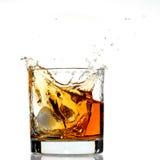 Spruzzata del whisky Immagini Stock