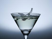 Spruzzata della goccia di acqua sul vetro di Champagne. Fotografia Stock Libera da Diritti
