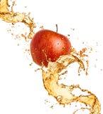 Spruzzata della spremuta e del Apple Fotografia Stock Libera da Diritti